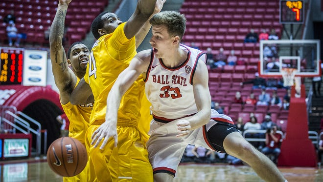 Ball State's Ryan Weber passes past Valparaiso's defense during the Cardinals' win at Worthen Arena, Nov. 28, 2015.