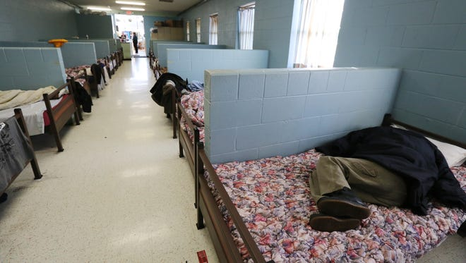 A client at the Healing Place sleeps in a bed at the detox center.  The center currently only has 24 beds.  The long-term goal is to expand the size of this facility because dozens of men everyday are turned away.December 15, 2015