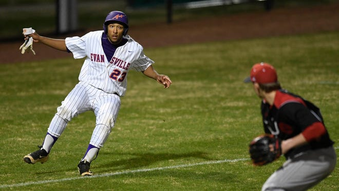 University of Evansville's Korbin Williams (23) looks to SIUE pitcher Mike Miller (51) as he tries to avoid a rundown between third base and home plate as the Aces play SIUE at Evansville's Braun Stadium Wednesday, March 29, 2017.