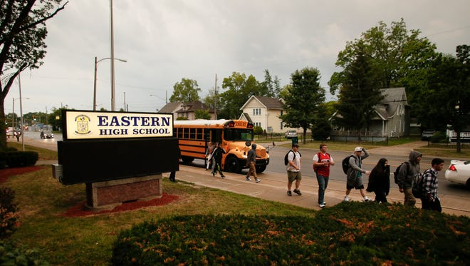 Students arrive at Lansing Eastern High in September for the first day of the 2017-18 school year. The school day at Lansing's three high schools begins at 7:25 a.m.