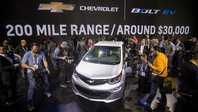 Showgoers get a closer look at the 2017 Chevrolet Bolt EV during its world debut at the Consumer Electronics Show on Jan. 6, 2016, in Las Vegas.