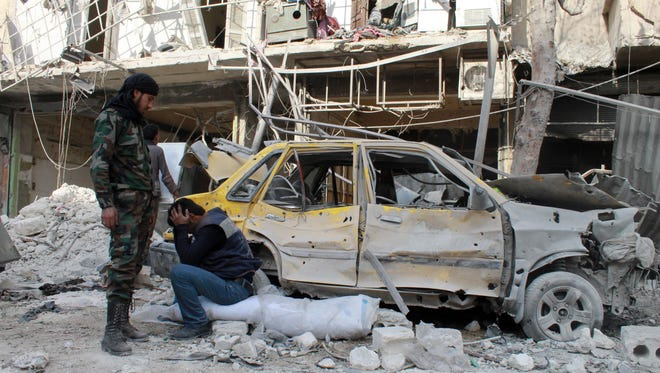 A man reacts to the destruction of his home  following a reported Syrian government forces air strike the day before, in the northern city of Aleppo on Feb. 10.