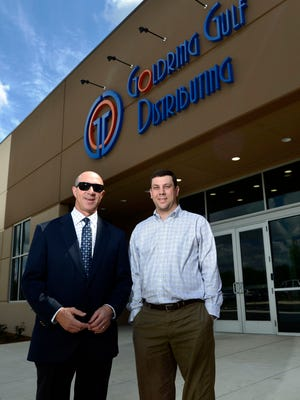 Elliot Maisel, CEO and Chairman of Gulf Distributing Holdings, L.L.C., and his son Evan Maisel, Vice President, are photographed outside the new Goldring Gulf Distributing facility at the Santa Rosa Industrial Park. The company built the new facility in Santa Rosa to consolidate their Pensacola and Fort Walton Beach locations.