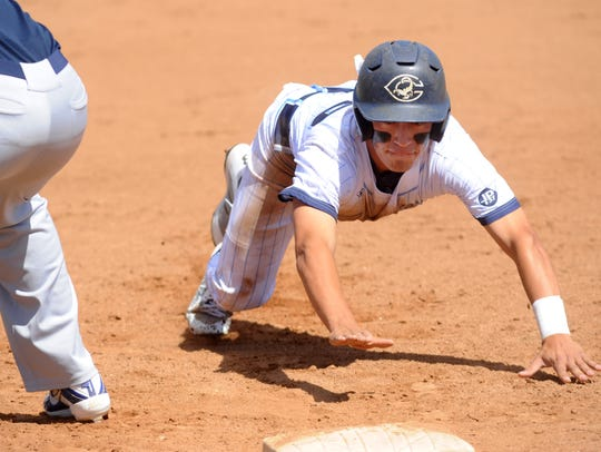 Sam Silveyra slides safely into first base safely on