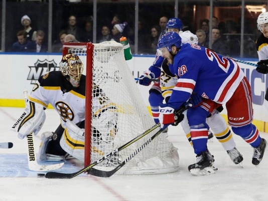Boston Bruins goalie Tuukka Rask (40) defends a shot by New York Rangers' Paul Carey (28) during the second period of an NHL hockey game Wednesday, Nov. 8, 2017, in New York. (AP Photo/Frank Franklin II)