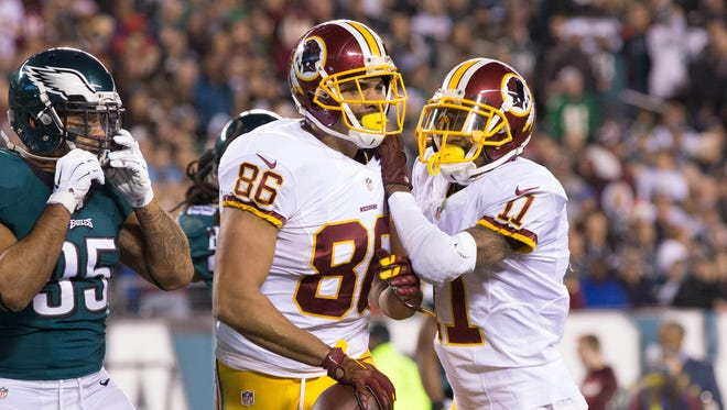 Washington Redskins tight end Jordan Reed (86) celebrates his touchdown with wide receiver DeSean Jackson (11) in front of Philadelphia Eagles inside linebacker Mychal Kendricks (95) during the first quarter at Lincoln Financial Field.