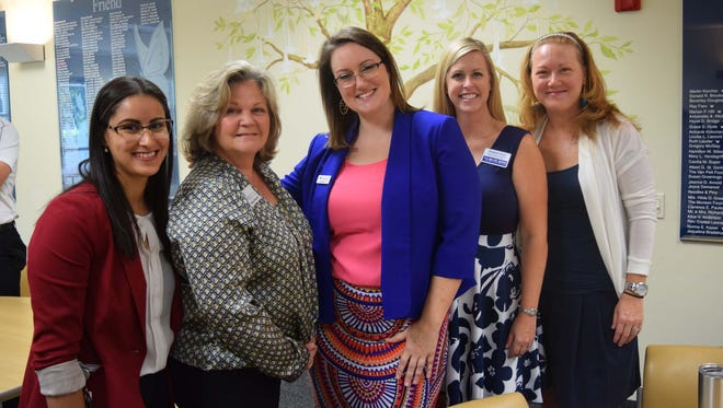 Community Conversations attendees, from left, Emmelis Keaney, Keaney Financial Services Corp.; Polly DeLater, Molly's House; Sarah Baker, First Citizens Bank; Elisabeth Glynn, United Way of Martin County; and Cindy Pilloni, PNC.