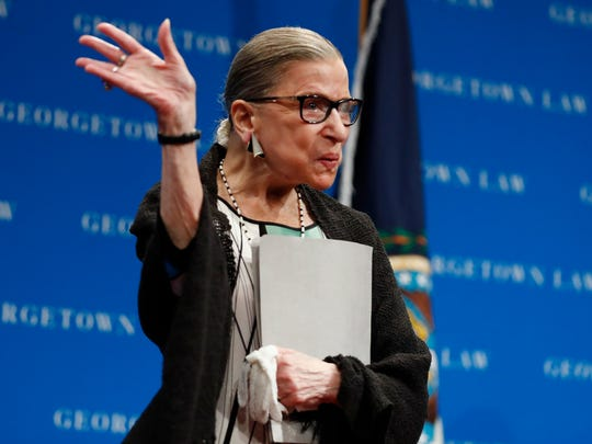 Supreme Court Justice Ruth Bader Ginsburg waves to first-year law students after speaking at Georgetown University Law Center in September.