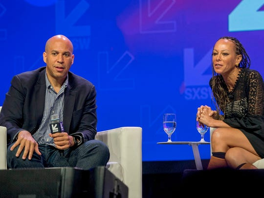 Senator Corey Booker and Malika Saada Saar, Senior