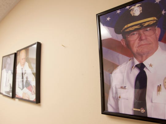 On a wall of portraits of past chiefs of Lake Como