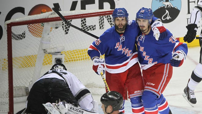 The Rangers' Martin St. Louis (26) celebrates his second-period goal with Chris Kreider in front of Kings goalie Jonathan Quick during Game 4 of the Stanley Cup Final at Madison Square Garden  Wednesday night.