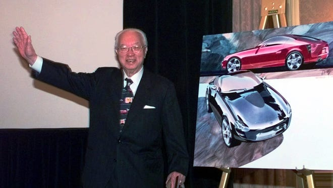 """In a 1998 file photo, Yutaka Katayama, the """"father of the Z"""" waves to the media after introducing Nissan's new Z car concept during a news conference in Dearborn, Mich."""