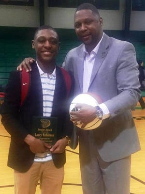 Larry Robinson III (left) and Larry Robinson II.