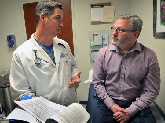 Dr. Jeremy Johnson, of Olney Hamilton Hospital, talks with John Ingle, the business editor for the Wichita Falls Times Record News, about the benefits of pharmacogenetic testing. The testing uses a patient's DNA to help identify risks of adverse reactions to medications and determine the most effective medications and dosages.