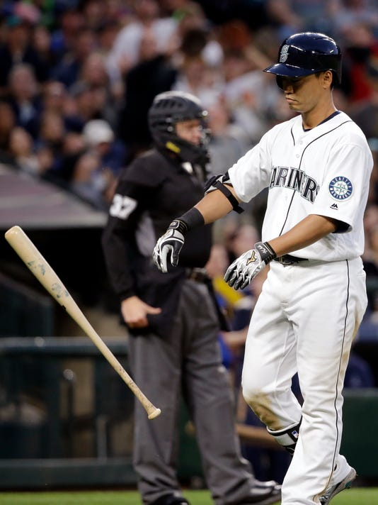 Seattle Mariners' Norichika Aoki tosses aside his bat after striking out against the Oakland Athletics to end the fifth inning in a baseball game Saturday, April 9, 2016, in Seattle. (AP Photo/Elaine Thompson)