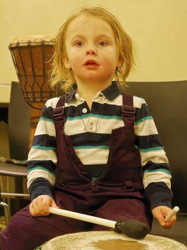 Gryffin Brassert plays a drum at the Baldwin Public