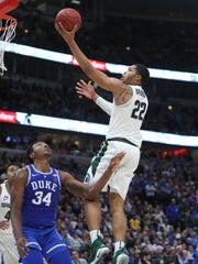 Michigan State's Miles Bridges drives against Duke's Wendell Carter Jr. during the second half of MSU's 88-81 loss on Tuesday, Nov. 14, 2017, in Chicago.