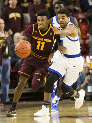 ASU guard Shannon Evans II (11) is pressured by Creighton  guard Maurice Watson Jr. (10) during the first half in Tempe, Ariz. December 20, 2016.