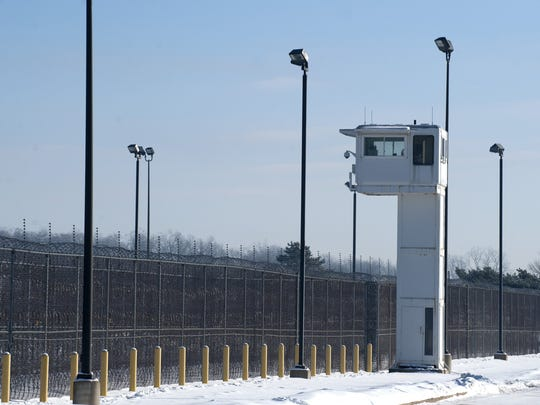 A guard tower looms over fencing surrounding the Ionia Correctional Facility. The writer suggests the state needs more humane corrections policies.
