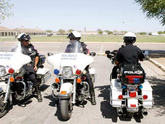 San Angelo police officers patrol Fort Concho National Historic Landmark on motorcycles.