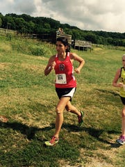 Rossview's Sara Martin tries to outrun the competition during a cross country meet this fall.