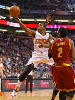 Suns guard Eric Bledsoe, making his return following a 10-week injury absence, goes up for a shot against Cleveland's Kyrie Irving during Wednesday's loss to the Cavaliers.