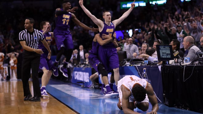 Isaiah Taylor #1 of the Texas Longhorns reacts after Paul Jesperson #4 of the Northern Iowa Panthers hit a half court three pointer to win the game with a score of 75 to 72 during the first round of the 2016 NCAA Men's Basketball Tournament at Chesapeake Energy Arena on March 18, 2016 in Oklahoma City