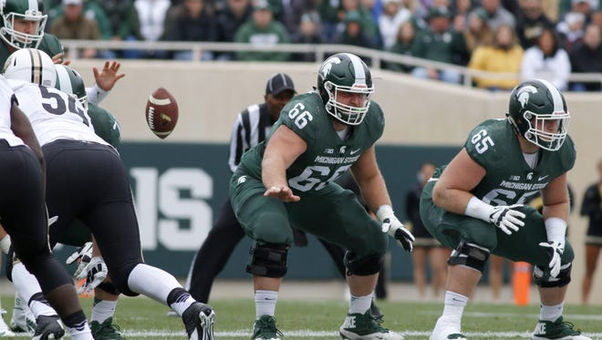 Outgoing senior center Jack Allen (66) played two seasons at MSU with his brother, Brian (65). Younger brother, Matt, will join now-junior Brian with the Spartans in the fall as a freshman offensive lineman.