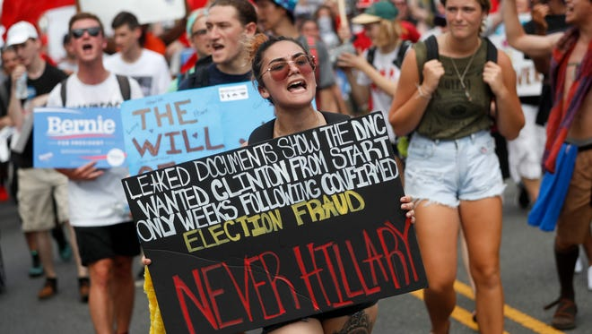 There was tension in the air before Tuesday night's roll call vote nominating Hillary Clinton president at the Democratic National Convention, with Bernie Sanders' supporters threatening disunity.