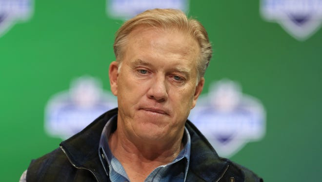 Denver Broncos executive vice president of operations John Elway speaks to the media during the 2017 NFL Combine at the Indiana Convention Center.