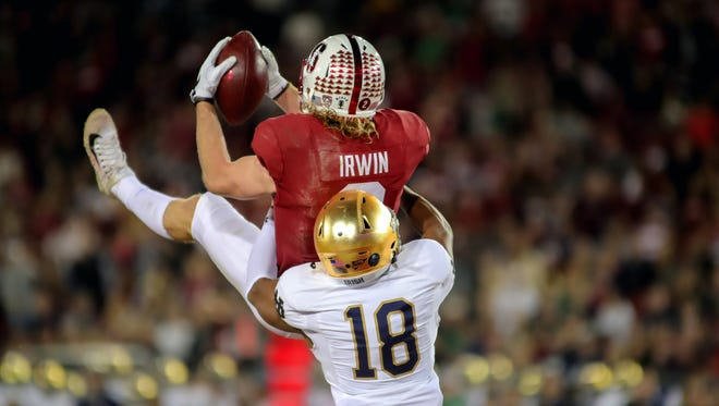 Stanford Cardinal wide receiver Trenton Irwin (2) catches a touchdown pass over Notre Dame Fighting Irish cornerback Troy Pride Jr. (18) during the first quarter at Stanford Stadium.