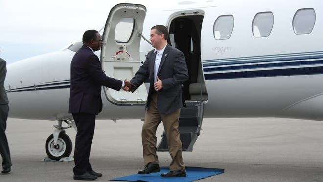 New MTSU men's basketball coach Nick McDevitt (right) shakes hands with MTSU president Sidney McPhee after landing in Murfreesboro on Monday afternoon.