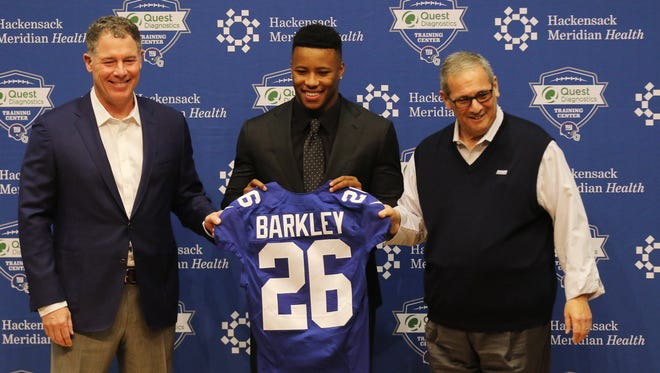 Giants head coach Pat Shurmur, first round draft pick Saquon Barkley and Giants general manager David Gettleman introducing Barkley to the media before his press conference.