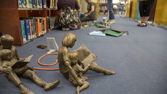 The Burton Barr Central Library will be open to the public on Saturday after a yearlong renovation sparked by a catastrophic failure in the building's sprinkler system, which flooded much of the building.