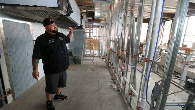 Joe Zolnierowski, executive chef of a new Mexican restaurant called Old Pueblo Grill, goes through the kitchen area of the restaurant that is still under construction.