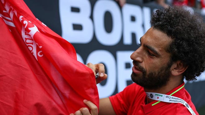 Liverpool's Mohamed Salah signs autographs following an International Champions Cup soccer match against Borussia Dortmund on Sunday.
