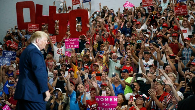 The crowd cheers as President Donald Trump arrives to speak at a rally at Olentangy Orange High School in Lewis Center, Ohio, Saturday, Aug. 4, 2018.