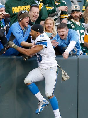 Lions wide receiver Golden Tate celebrates after the win over the Packers in Green Bay, Wis., Sunday.
