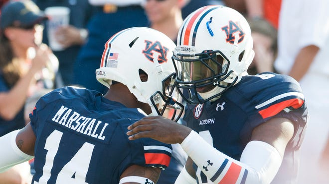 Could Auburn put quarterbacks Nick Marshall and Jeremy Johnson on the field at the same time? Gus Malzahn wouldn't rule it out.