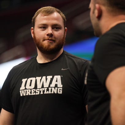 Iowa Hawkeyes wrestler Sam Stoll injured in accidental shooting, police say