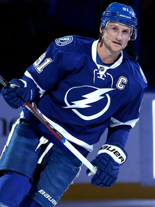 Tampa Bay Lightning center Steven Stamkos (91) is introduced as the new caption of the Lightning before an NHL hockey game against the Buffalo Sabres Thursday, March 6, 2014, in Tampa, Fla. (AP Photo/Chris O'Meara)