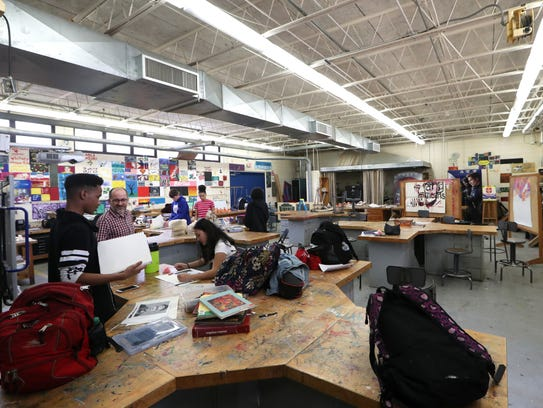 Students work in an art class at Rickards, within one