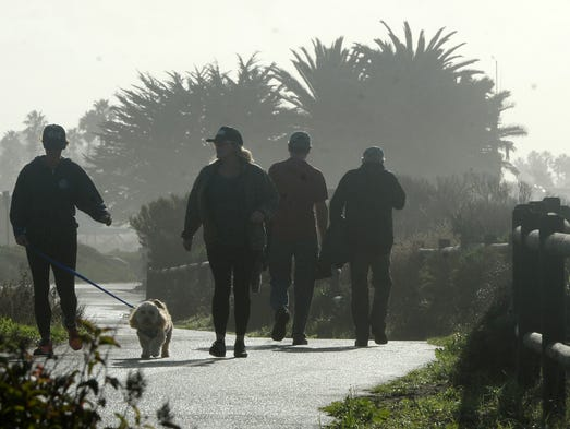 Folks take a morning walk Wednesday at San Buenaventura