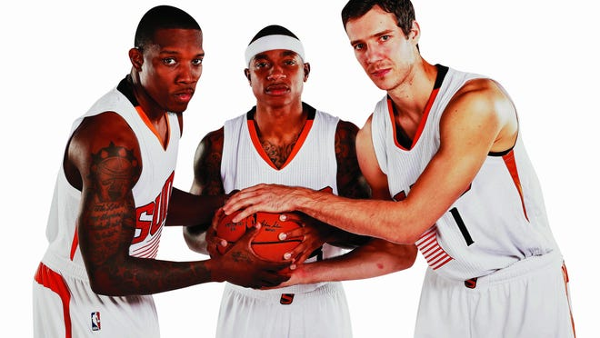 Suns guards (from left) Eric Bledsoe, Isaiah Thomas and Goran Dragic will have to learn to share the ball this season. Thomas, a newcomer, was a starter and leading scorer for Sacramento, but in Phoenix, he'll be a sixth man. Rob Schumacher/ azcentral sports