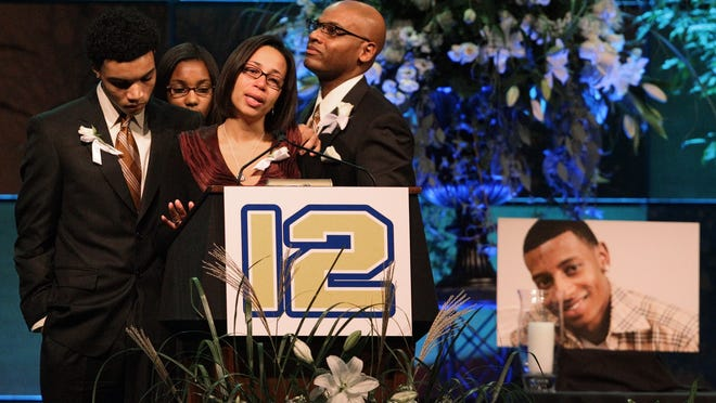 """FILE - Hundreds, including DJ's brother Kyle Henry, right, DJ's sister Amber Henry, second from right, and best friend Brandon Cox, third from right, showed up for the candlelight prayer vigil held in Easton, Oct. 18, 2010, in honor of the late Danroy """"DJ"""" Henry Jr., who was shot and killed by a police officer in New York."""