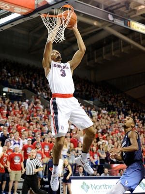 Gonzaga Bulldogs forward Johnathan Williams (3) goes up for the dunk against the San Diego Toreros during the first half at McCarthey Athletic Center.