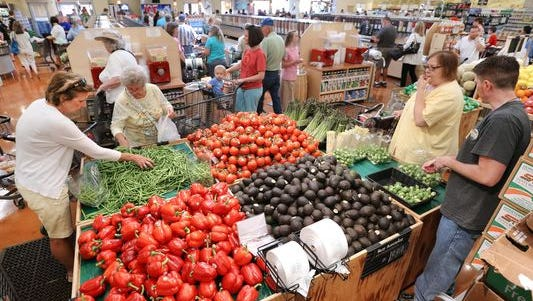 The opening of Fresh Thyme Farmers Market in Greenwood, Ind., drew a crowd to check out the new store on June 12, 2014.