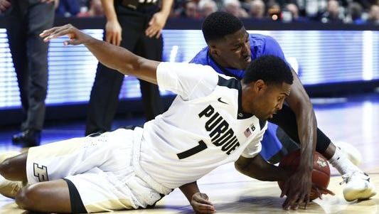 Purdue point guard Johnny Hill battles for a loose ball against Florida.