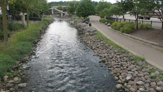 This photo taken Sept. 12, 2013, shows the Fox River where it flows through downtown Waukesha, Wis.