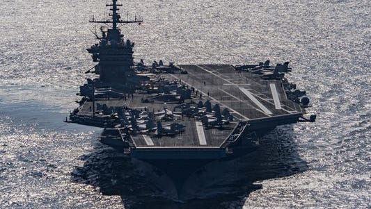 The aircraft carrier USS Harry S. Truman transits the Gulf of Oman.